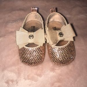 Gold dress shoes for a 6-9 month old baby girl.